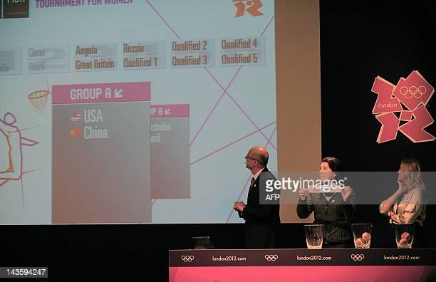 Basketball International Federation Sports Director and former basketball player Lubomir Kotleba looks at the screen as Brazilian basketball former...