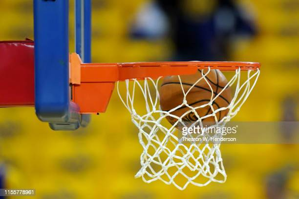 Basketball is shot through the hoop during warmups prior to Game Six of the 2019 NBA Finals between the Golden State Warriors and the Toronto Raptors...