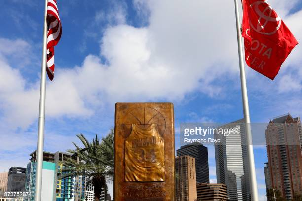 A basketball jersey monument honoring former Houston Rockets player Hakeem Olajuwon is displayed outside Toyota Center home of the Houston Rockets...