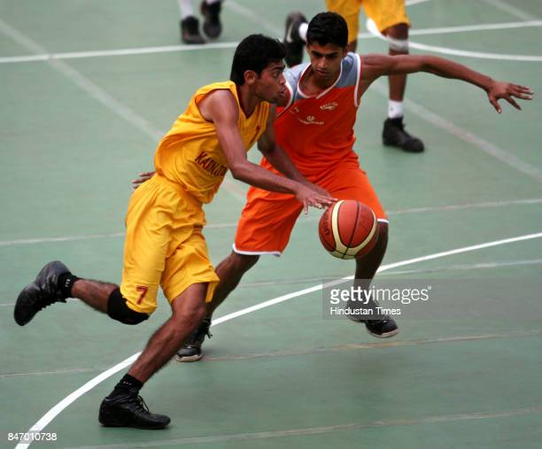 Basketball Karnataka's Varun tries to get past a Services player in a men's super league match of the All India Savio Cup Basketball Tournament at...