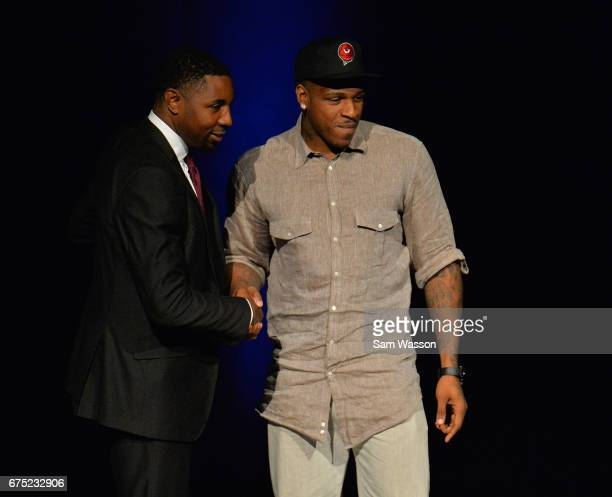 BIG3 basketball league President and Commissioner Roger Mason Jr greets Rashad McCants after he was selected number one overall in the 2017 BIG3...