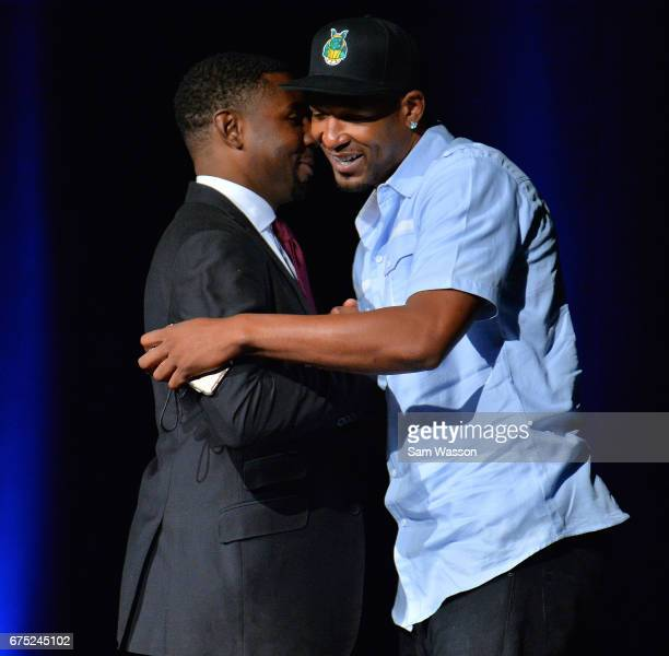 BIG3 basketball league President and Commissioner Roger Mason Jr greets Dominic McGuire after he was selected in the 2017 BIG3 draft at Planet...
