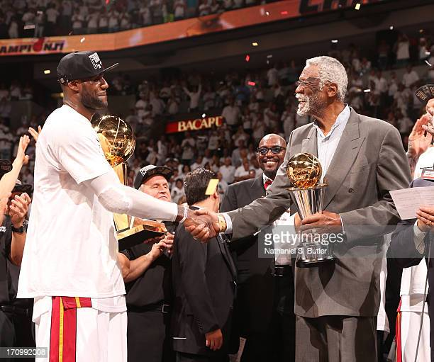 Basketball legend Bill Russell presents LeBron James of the Miami Heat with the Bill Russell NBA Finals Most Valuable Player Award after the Miami...