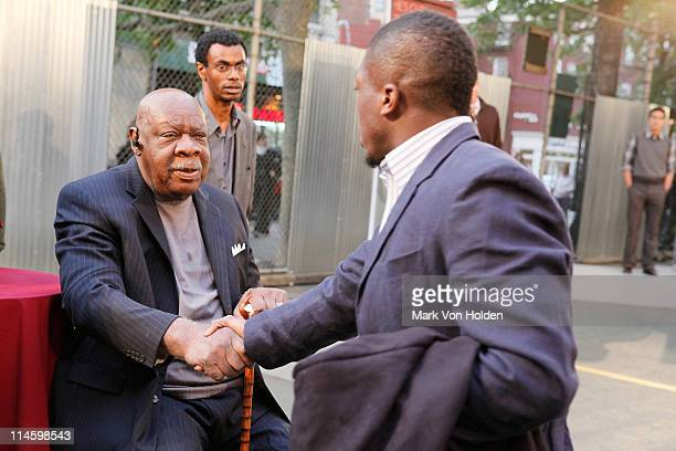 Basketball legend Cal Ramsey shakes hands with New York Knicks Nate Robinson at the fall 2009 collection preview for JOE Joseph Abboud and JCPenney...