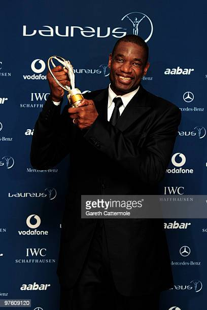 US basketball legend Dikembe Mutombo poses with his award for 'Sport For Good ' in the Awards room during the Laureus World Sports Awards 2010 at...