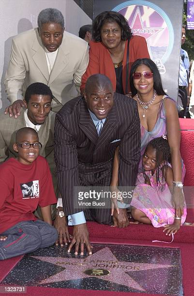 Basketball legend Earvin 'Magic' Johnson center poses with his family during ceremony honoring him with the 2180th star on the Hollywood Walk of Fame...