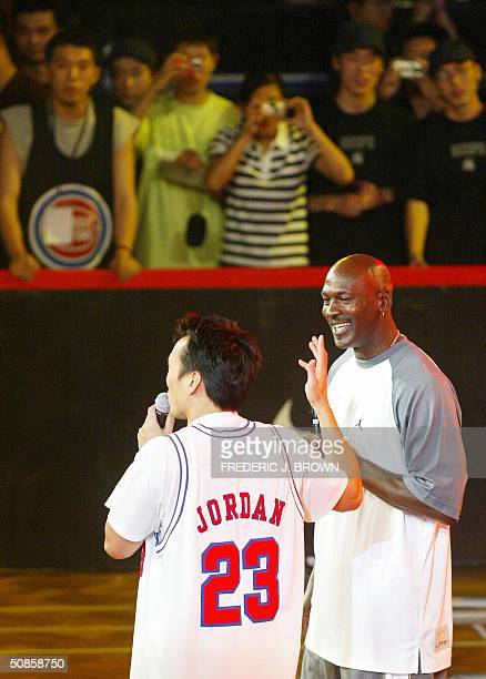 US basketball legend Michael Jordan is introduced to fans as he arrives for a presentation ceremony for China's High School championship 20 May 2004...