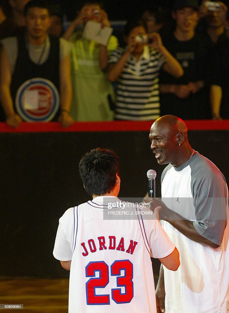 US basketball legend Michael Jordan is introduced to fans prior to a presentation ceremony for China's high school championship, 20 May 2004, at the Worker's Stadium Gymnasium in Beijing. Despite being a no show at open public events in the Chinese capital yesterday, Jordan's slick promotional tour has grabbed more headlines than the return to China of the nation's homegrown NBA hero Yao Ming. AFP PHOTO/Frederic J. BROWN ...
