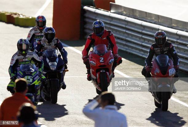 US basketball legend Michael Jordan powers a motorcycle flanked by US Curty Roberts Spanish Sete Gibernau US Kenny Roberts and US Collin Edwars...
