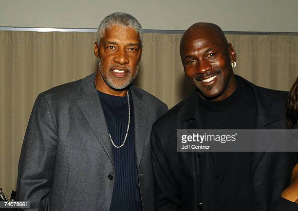 NBA basketball legends Julius Dr J Erving and Michael Jordan pose at the Muhammad Ali birthday celebration and VIP Reception during the events for...