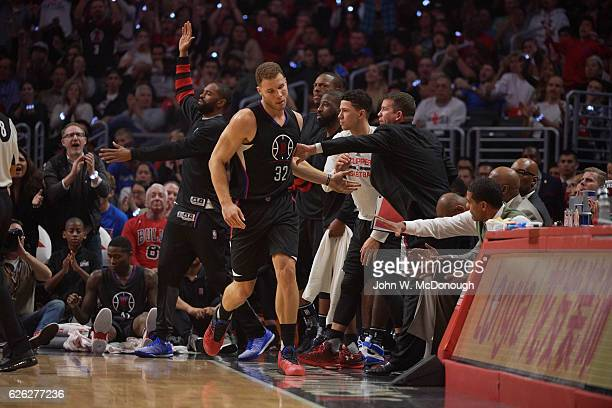 Los Angeles Clippers Blake Griffin on sidelines with teammates during game vs Chicago Bulls at Staples Center Los Angeles CA CREDIT John W McDonough