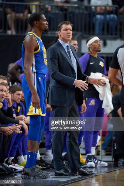 Los Angeles Lakers coach Luke Walton on sidelines with Golden State Warriors Kevin Durant during preseason game at T Mobile Arena Las Vegas NV CREDIT...