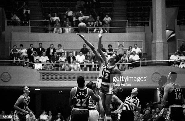 Los Angeles Lakers Gene Wiley in action vs San Francisco Warriors Wilt Chamberlain during preseason at Los Angeles Memorial Sports Arena Los Angeles...