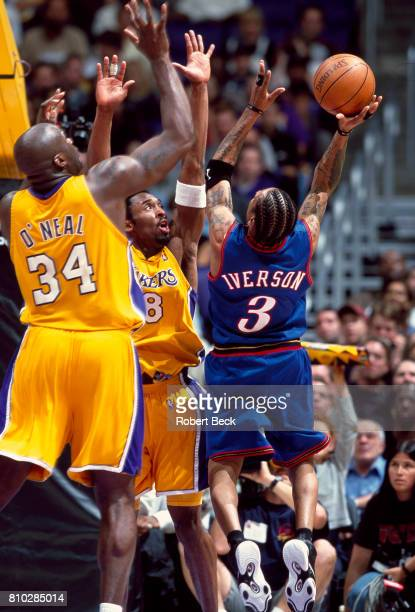 Los Angeles Lakers Kobe Bryant and Shaquille O'Neal in action defense vs Philadelphia 76ers Allen Iverson at Staples Center Los Angeles CA CREDIT...