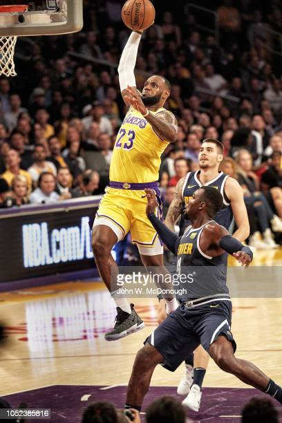Los Angeles Lakers LeBron James in action dunk vs Denver Nuggets during preseason game at Staples Center Los Angeles CA CREDIT John W McDonough