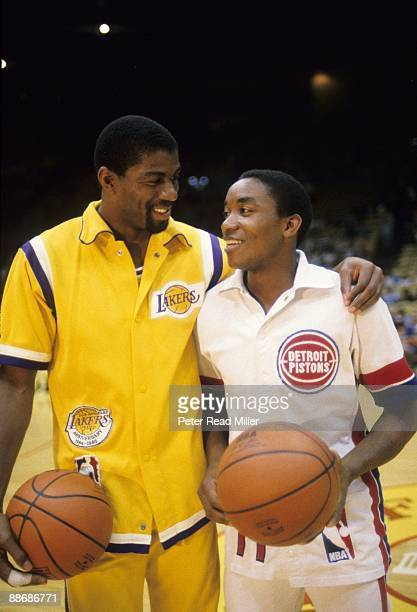 Los Angeles Lakers Magic Johnson and Detroit Pistons Isiah Thomas before game Inglewood CA 3/24/1985 CREDIT Peter Read Miller
