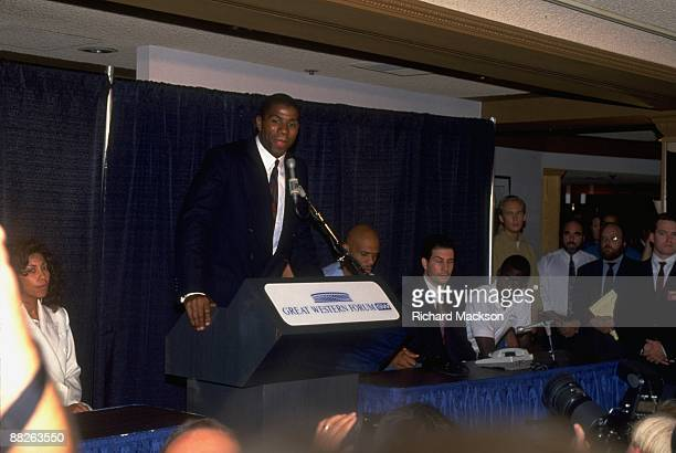 Los Angeles Lakers Magic Johnson announces to media that he has the HIV virus and would retire Johnson's wife Cookie is sitting in the foreground...