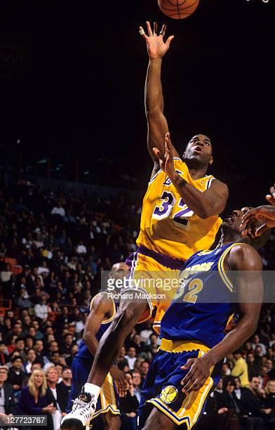 Los Angeles Lakers Magic Johnson in action vs Golden State Warriors Joe Smith at Great Western Forum Inglewood CA CREDIT Richard Mackson