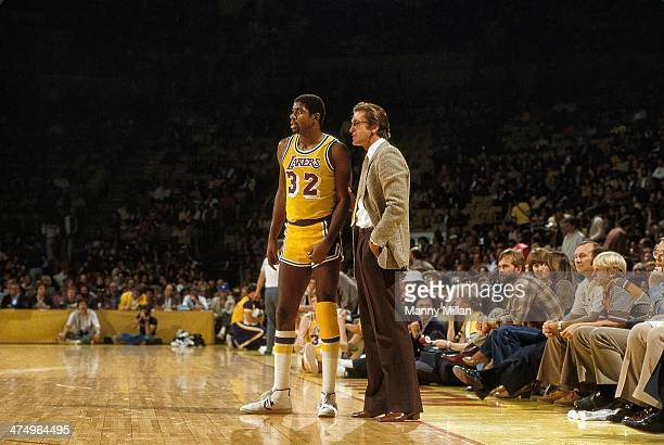 Los Angeles Lakers Magic Johnson with assistant coach Pat Riley on sidelines during game vs San Antonio Spurs at The Forum Inglewood CA CREDIT Manny...
