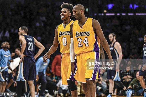 Los Angeles Lakers Nick Young victorious walking off the court after scoring 3point shot from Kobe Bryant assist during game vs Memphis Grizzlies at...