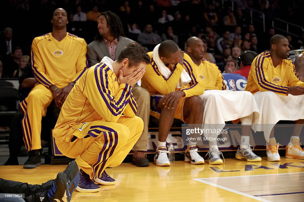 Los Angeles Lakers Stve Nash (10) looking upset with (L-R) Dwight Howard (12), Jordan Hill, Metta World Peace (15), Kobe Bryant (24), and Antwan Jamison (4) on the bench during game vs Oklahoma City Thunder at Staples Center. John W. McDonough F404 )
