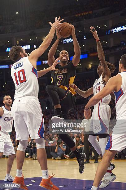 Los Angeles Lakers Xavier Henry in action shot vs Los Angeles Clippers Spencer Hawes and Chris DouglasRoberts at Staples Center Los Angeles CA CREDIT...