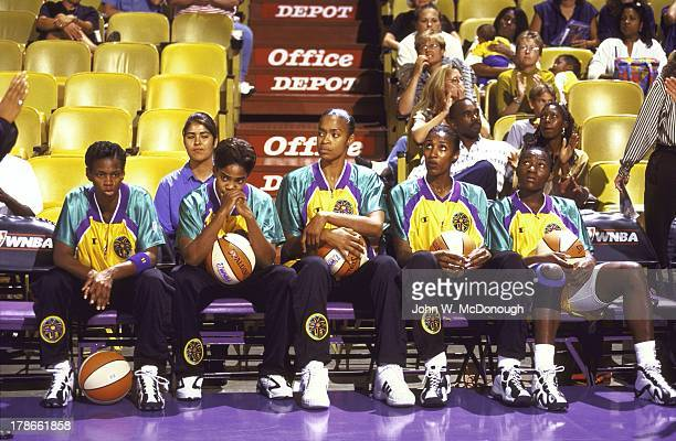 Los Angeles Sparks players Penny Toler Tamecka Dixon Octavia Blue Lisa Leslie and Mwadi Mabika on sidelines bench during introductions before game vs...