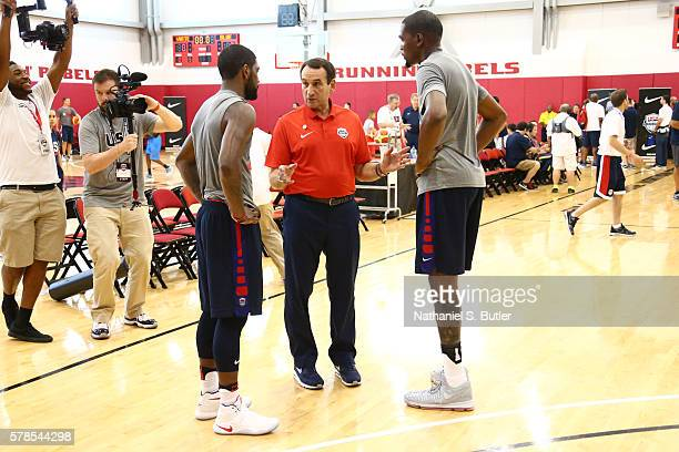 Basketball Mens National Team Head Coach Mike Krzyzewski speaks with Kyrie Irving and Kevin Durant of the USA Basketball Men's National Team during...