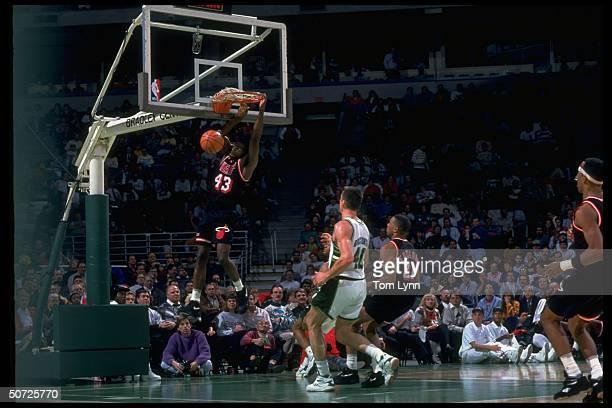 Miami Heat's Grant Long in action dunking vs Milwaukee Bucks