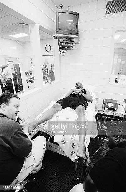 Milwaukee Bucks Glenn Robinson getting foot massage on trainer's table at Bradley Center Milwaukee WI CREDIT Bill Frakes