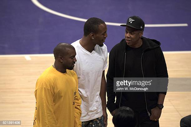 Musicians Jay Z with Kanye West courtside before Los Angeles Lakers vs Utah Jazz game at Staples Center Final game of Kobe Bryant's career Los...