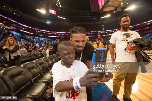 NBA All Star Game Celebrity actor and comedian Nick Cannon posing for photo with fan before game at Smoothie King Center New Orleans LA CREDIT...