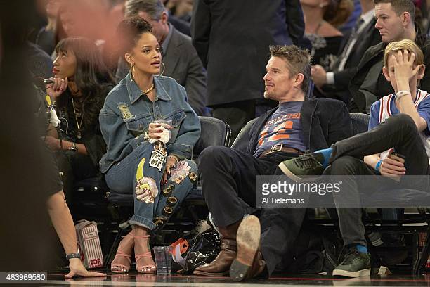 NBA All Star Game Celebrity singer Rihanna with actor Ethan Hawke sitting courtside during Team East vs Team West game at Madison Square Garden New...