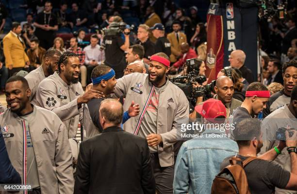 NBA All Star Game Team West DeAndre Jordan Team East Carmelo Anthony and Team West DeMarcus Cousins before game at Smoothie King Center New Orleans...