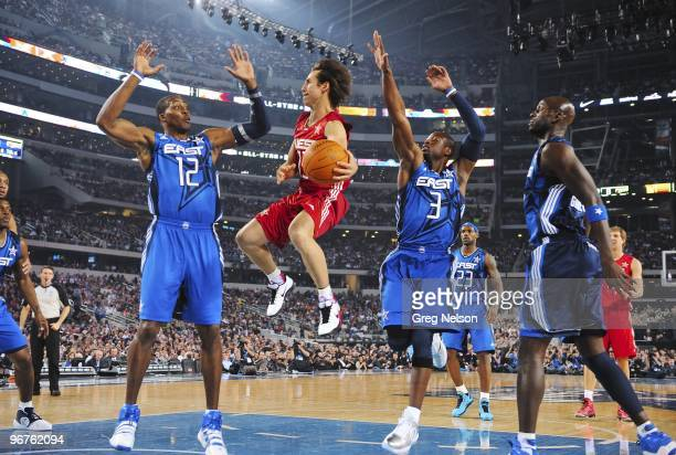 NBA All Star Game Team West Steve Nash in action vs Team East Dwight Howard and Dwyane Wade during All Star Weekend at Cowboys Stadium Arlington TX...