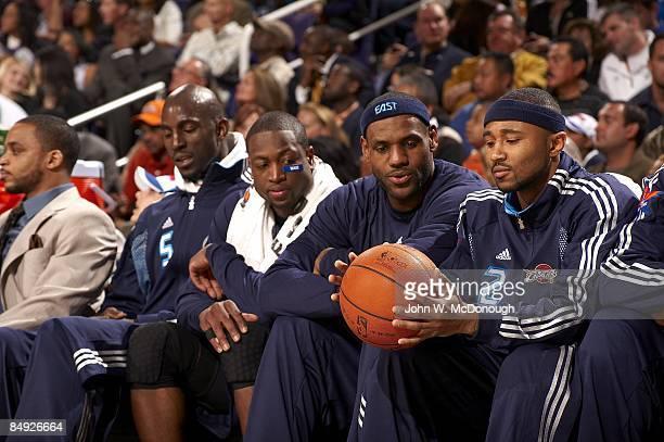 NBA AllStar Game Team East Kevin Garnett Dwyane Wade LeBron James and Mo Williams sitting on bench before start of game vs Team West Phoenix AZ...