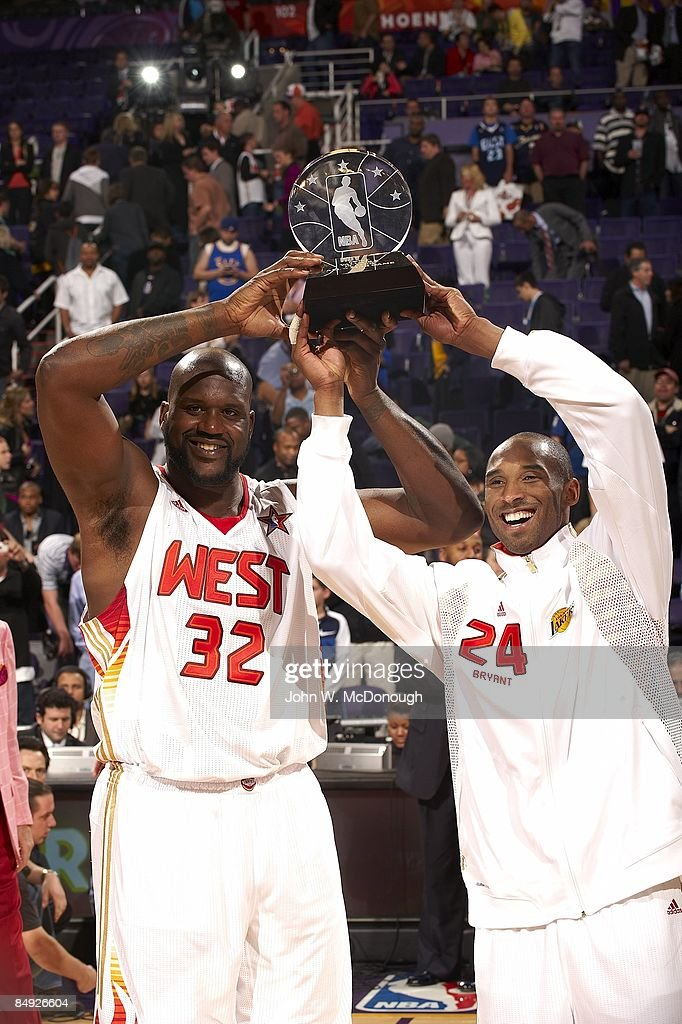 29d850f4f512 Team West Shaquille O Neal and Kobe Bryant hold up MVP trophy after ...