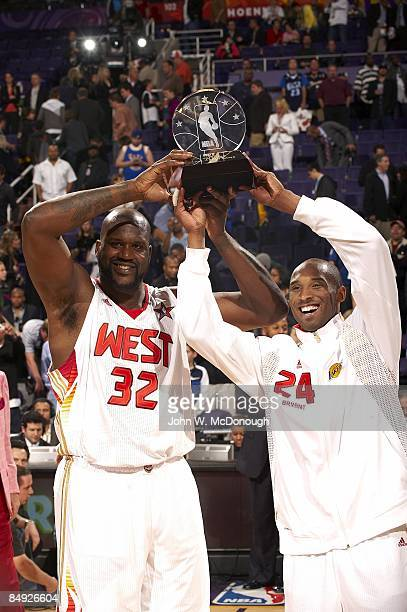 NBA AllStar Game Team West Shaquille O'Neal and Kobe Bryant hold up MVP trophy after game vs Team East O'Neal and Bryant were CoMVPs Phoenix AZ...