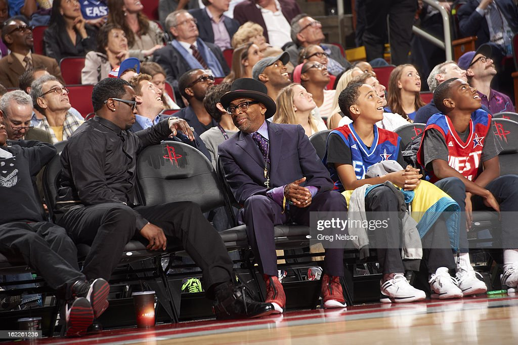 View of celebrity rapper Sean Diddy Combs and film director Spike Lee seated courtside during game during All-Star Weekend at Toyota Center. Greg Nelson F61 )