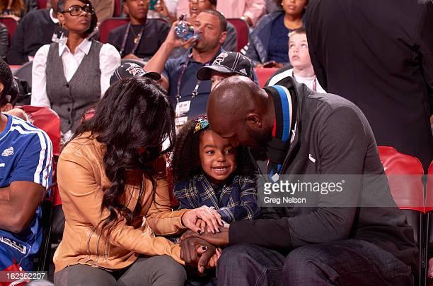 NBA AllStar Saturday Night Boston Celtics Kevin Garnett with his girlfriend Brandi Padilla and their daughter capri Garnett on sidelines during...