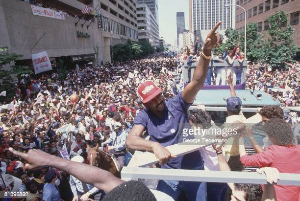 Basketball NBA championship Philadelphia 76ers Moses Malone during victory parade after winning finals vs Los Angeles Lakers View of fans...