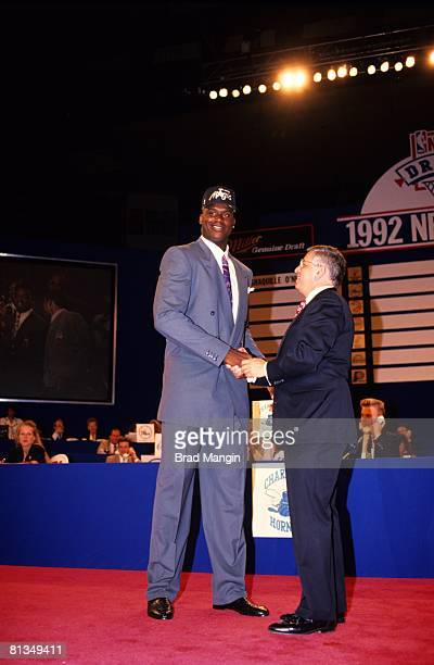 Basketball NBA Draft Orlando Magic Shaquille O'Neal with commissioner David Stern Portland OR 6/18/1992