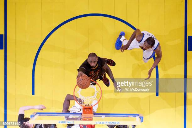 NBA Finals Aerial view of Cleveland Cavaliers LeBron James in action dunking vs Golden State Warriors at Oracle Arena Game 5 Oakland CA CREDIT John W...
