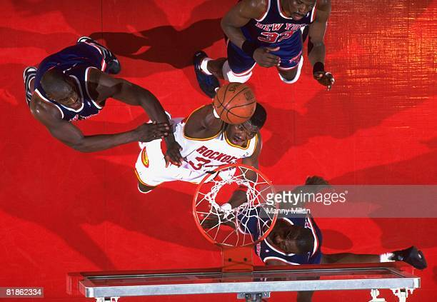 Basketball NBA Finals Aerial view of Houston Rockets Hakeem Olajuwon in action making dunk vs New York Knicks Game 7 Houston TX 6/22/1994