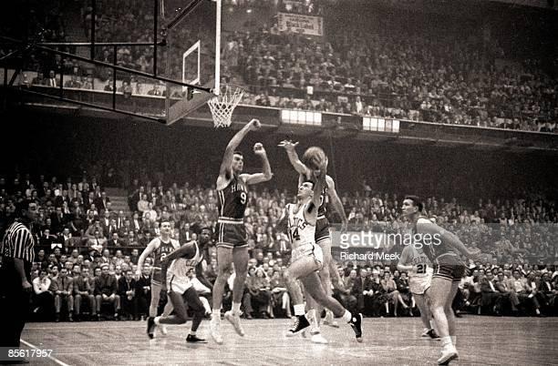 NBA Finals Boston Celtics Bob Cousy in action layup vs St Louis Hawks Bob Pettit Boston MA 3/30/19574/13/1957 CREDIT Richard Meek