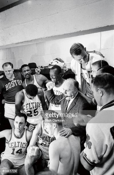 Basketball NBA Finals Boston Celtics coach Red Auerbach victorious during celebration with Bob Cousy Bill Russell and Sam Jones in locker room after...