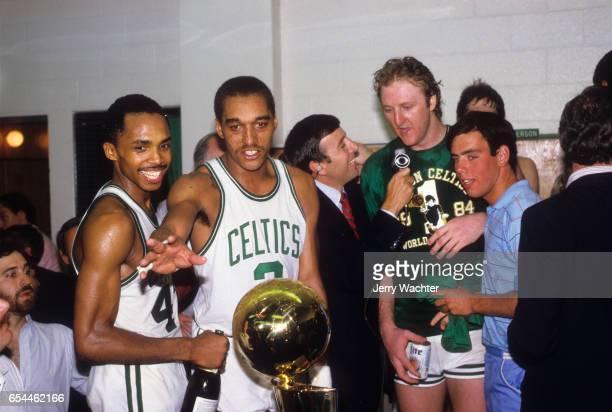 NBA Finals Boston Celtics Gerald Henderson Dennis Johnson Larry Bird and teammates victorious with Larry O'Brien Championship Trophy in locker room...