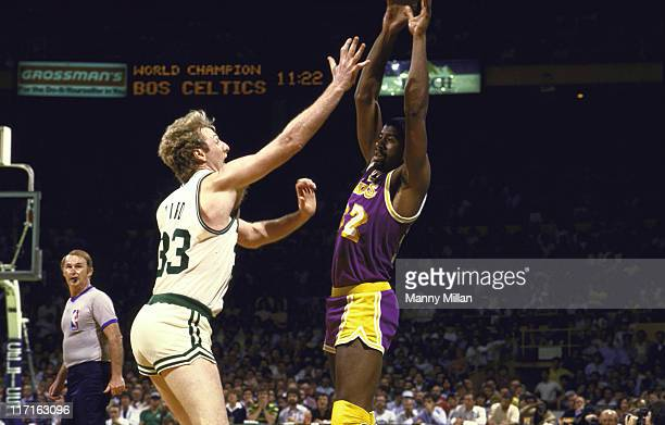 NBA Finals Boston Celtics Larry Bird in action defense vs Los Angeles Lakers Earvin 'Magic' Johnson during game at Boston Garden Game 1 Boston MA...