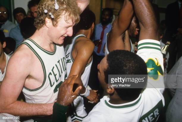 NBA Finals Boston Celtics Quinn Buckner victorious in locker room and pouring champagne over Larry Bird after winning Game 7 and championship series...