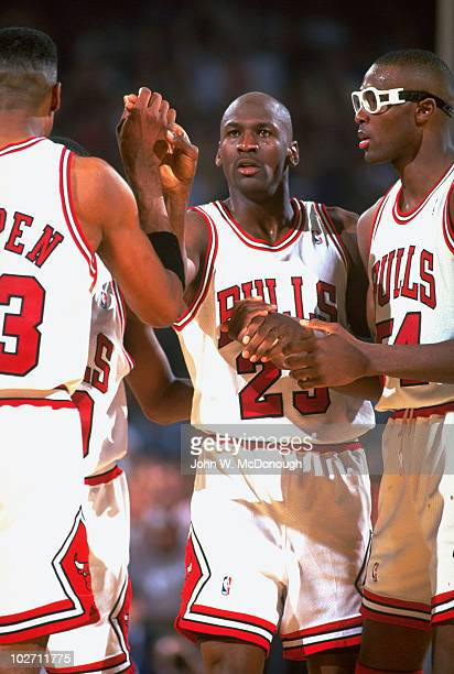 NBA Finals Chicago Bulls Michael Jordan giving highfive to Scottie Pippen and holding hands with Horace Grant during Game 4 vs Phoenix Suns Chicago...